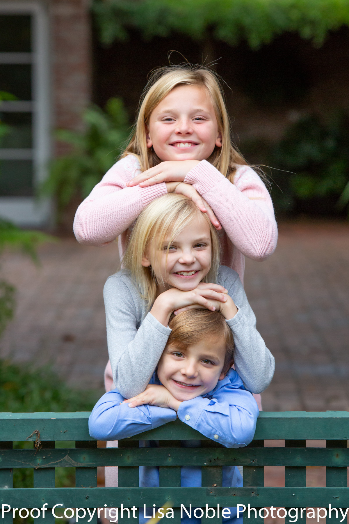 Three siblings on Bench during family photography session
