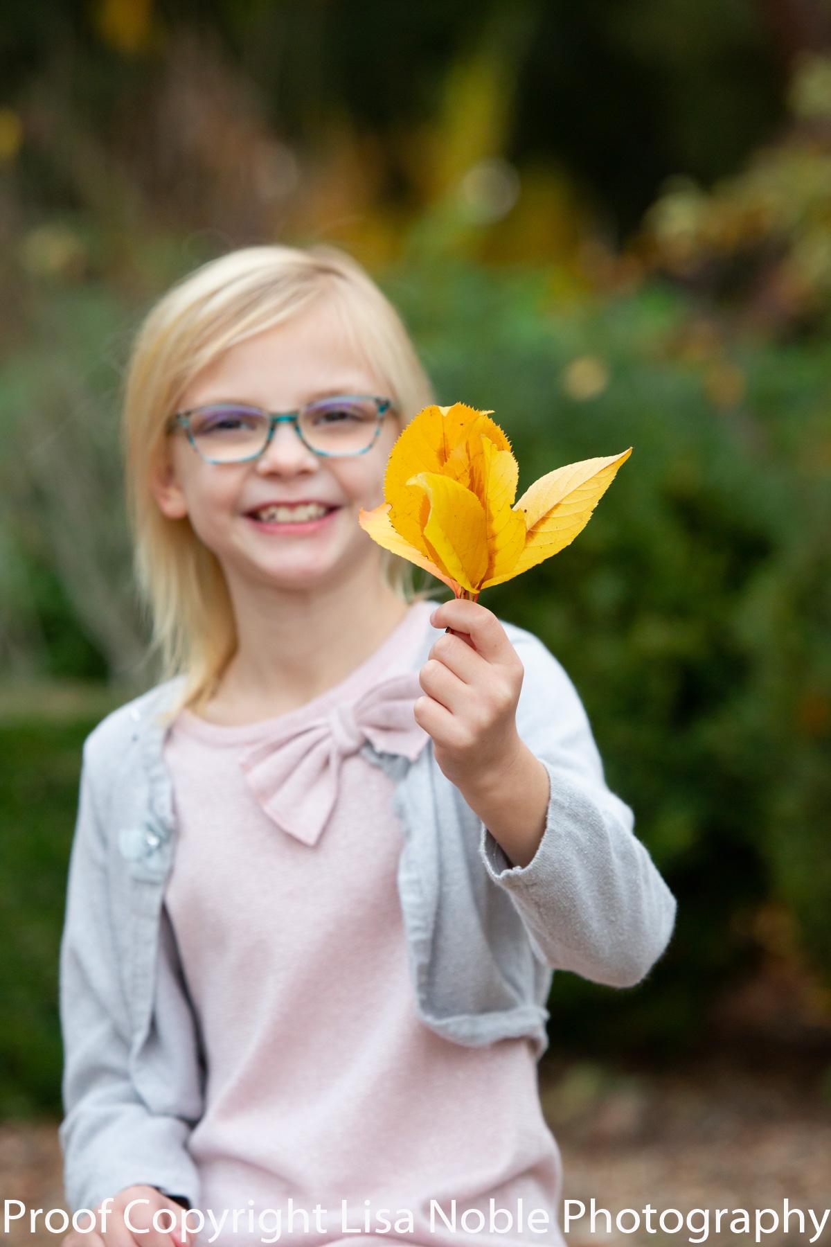 Girl holding leaf San Carlos Professional Portrait Photoragoy